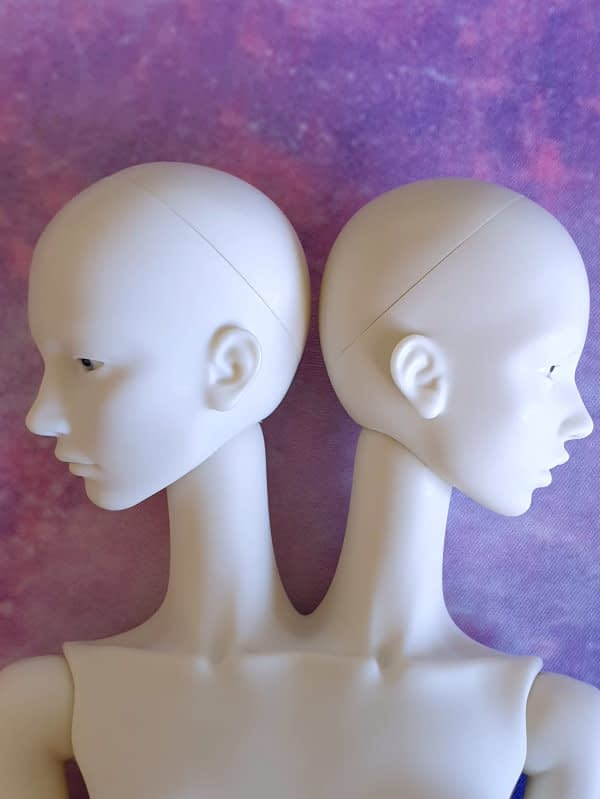 Metis doll heads pose ability oppose
