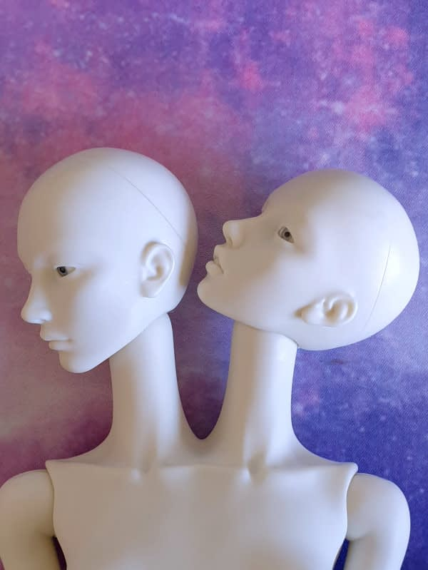Metis doll heads pose ability left